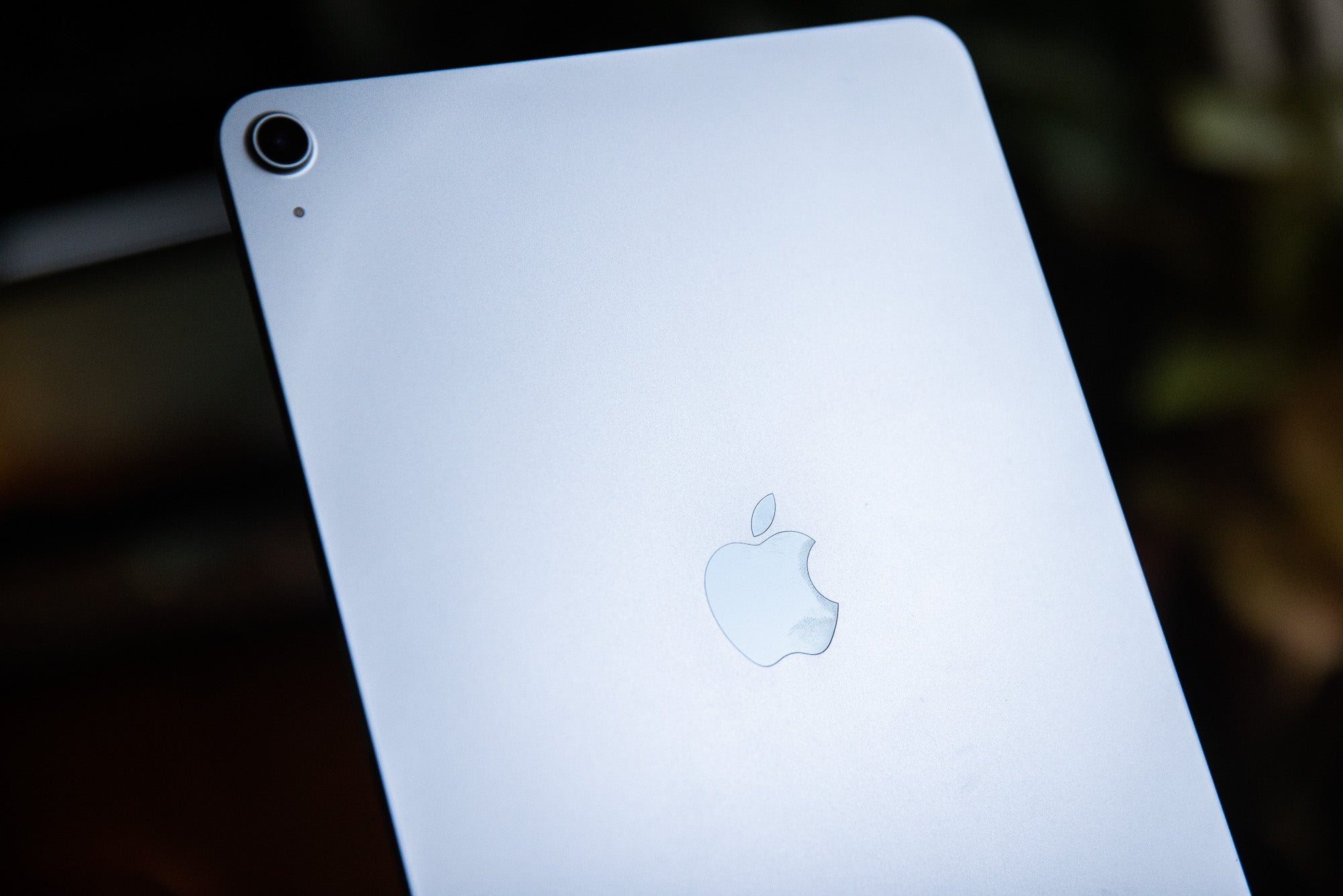 An iPad against a dark background