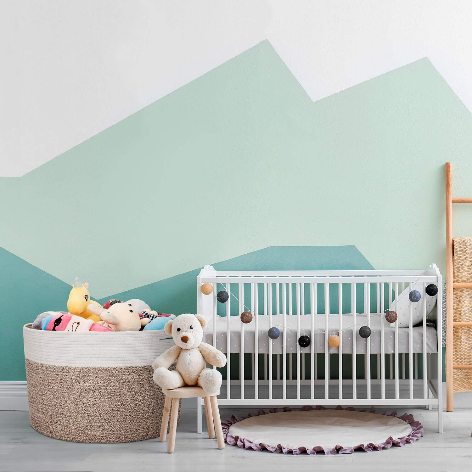 kid's room with a crib, toy basket, and other decorations