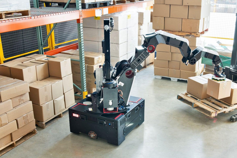 Boston Dynamics Stretch robot picking up boxes