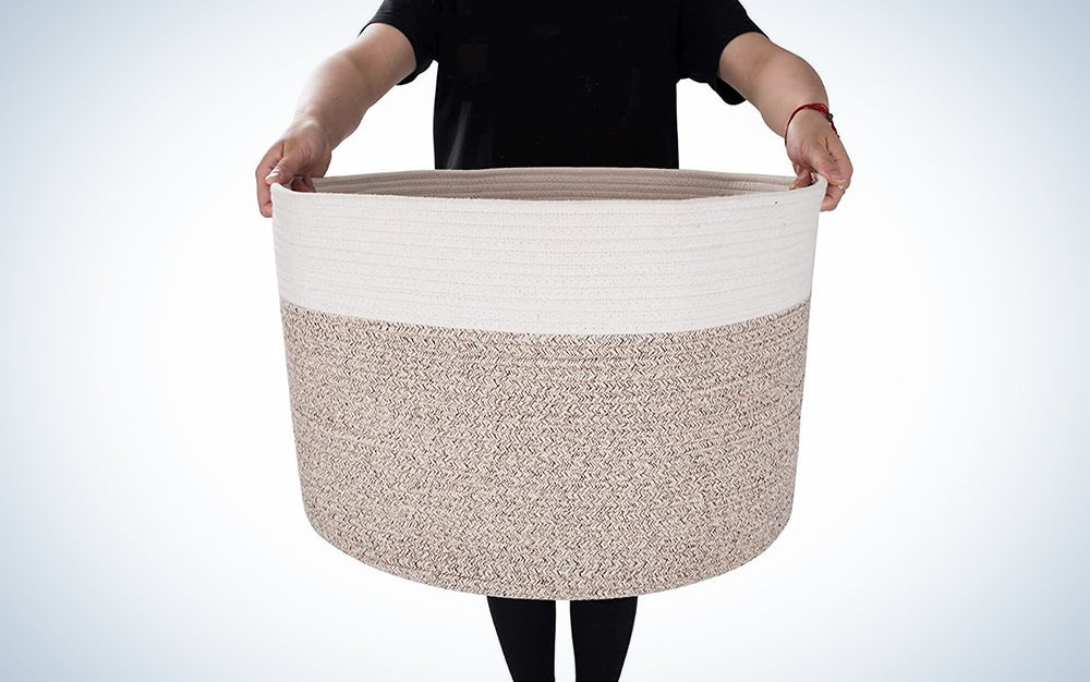 white and beige woven toy basket