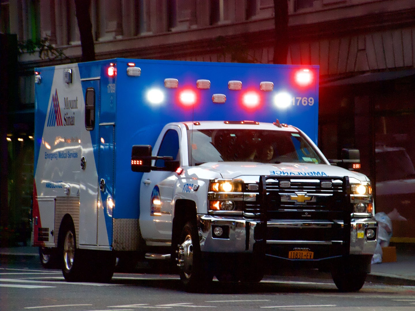 A Mount Sinai ambulance with its lights on in New York City.