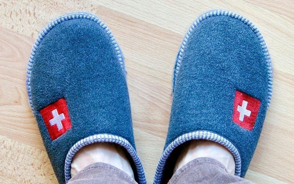 Man wearing blue slippers