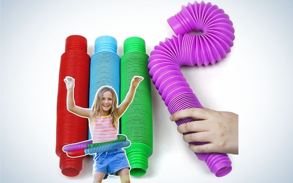 Different colored BunMo Toys with a girl playing with them and someone touching the toy.