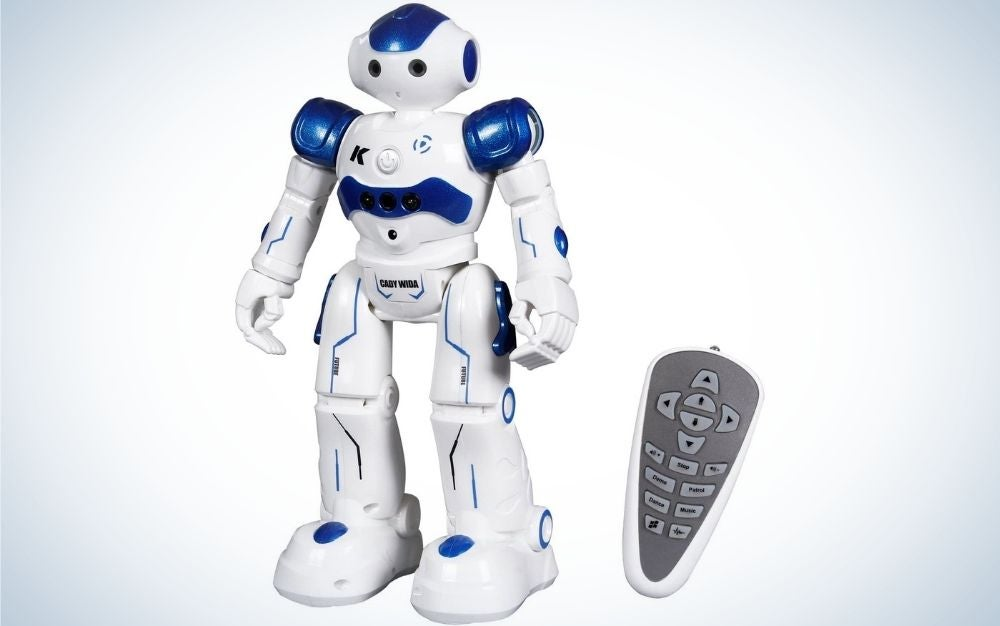 White and blue Cady Wida robot standing and a grey remote beside it.