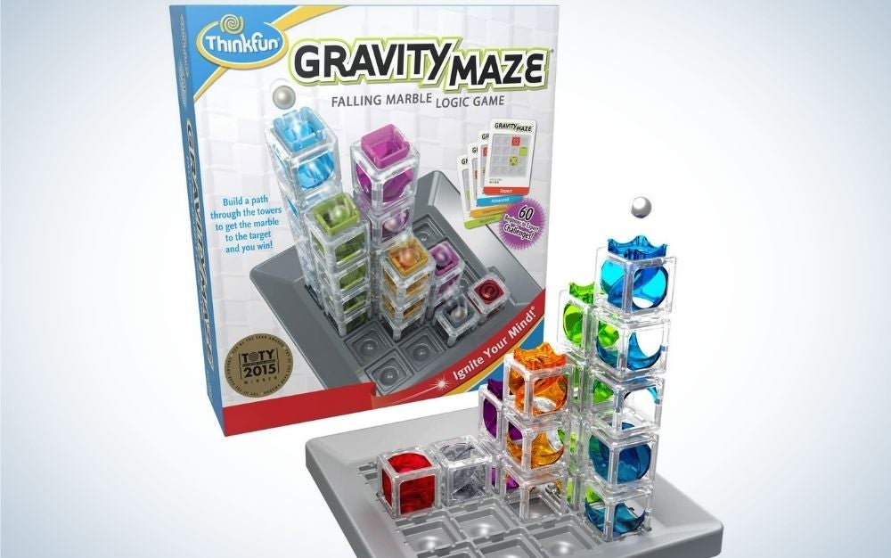 Colorful ThinkFun Gravity Maze with falling marble and logic games structured with crystal boxes and colored marbles.