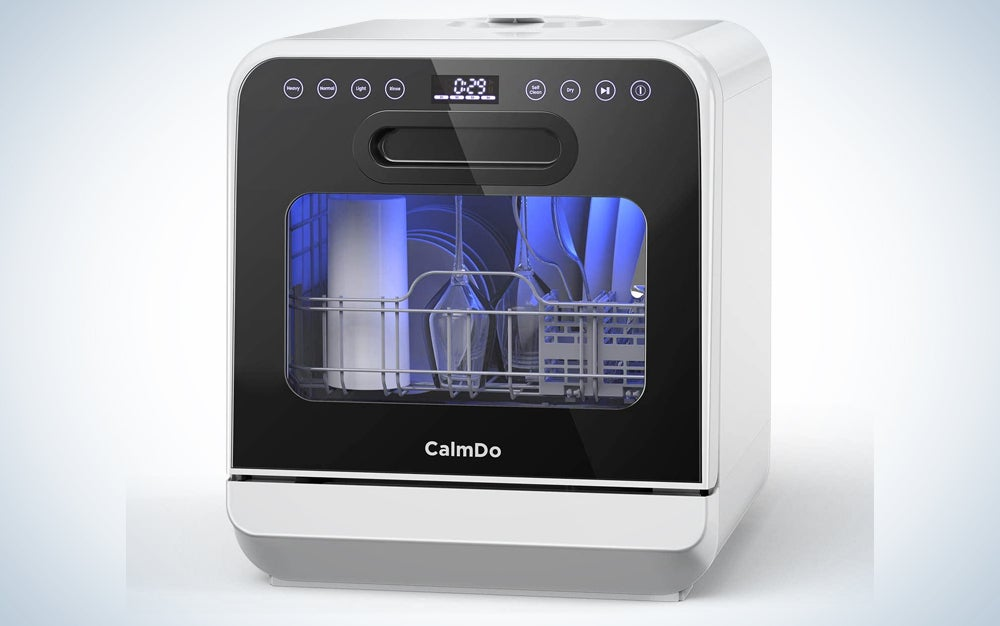 white countertop dishwasher with black front and see-through panel and blue LED lights inside