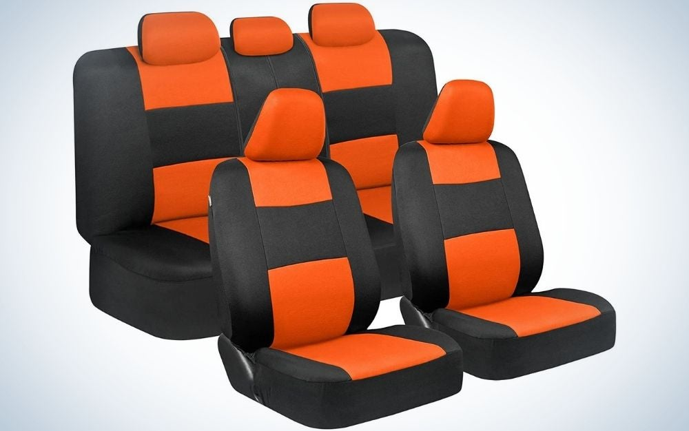Two black and orange seats with double black and orange sets besides them.
