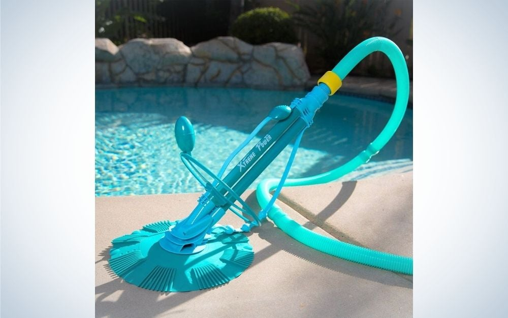 A sky color extreme power vacuum cleaner with a pool at the back.