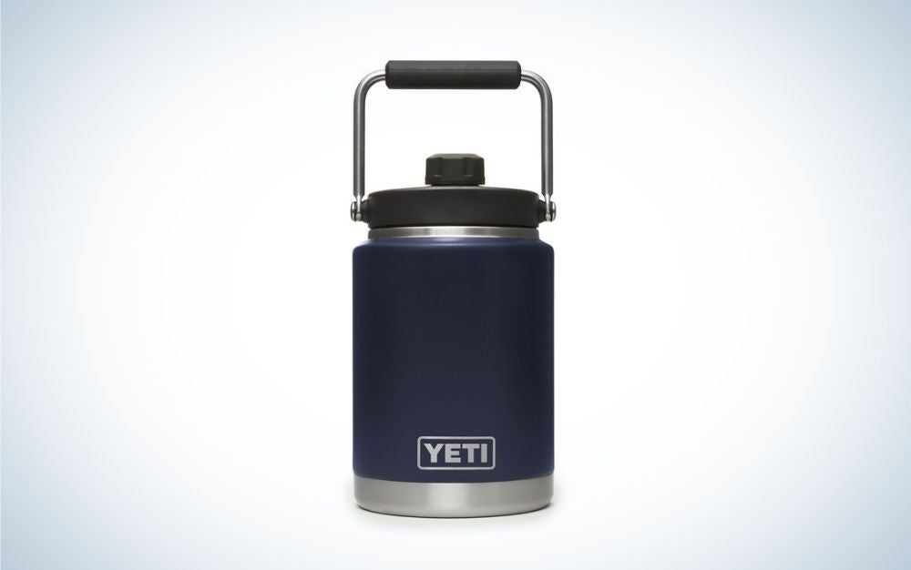 A cylindrical blue dark gallon with black lid cover.
