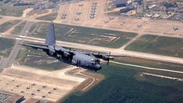 AC 130 Spectre Gunship over an airfield in Florida