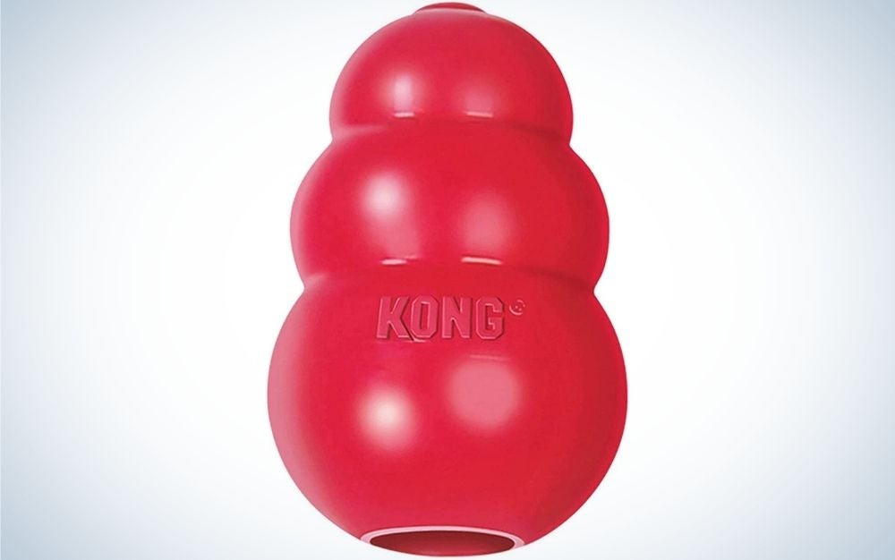 A red classic dog toy looking like three balls of different sizes in one.