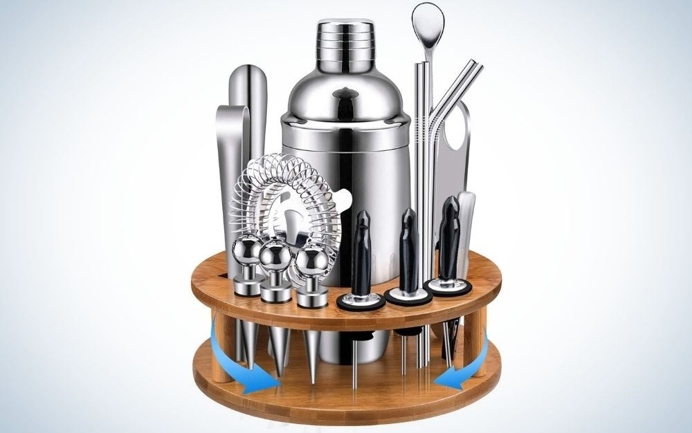 Cocktail Shaker Set with 9 items on it on silver color and with bamboo rotating stand wooden bar set tools.