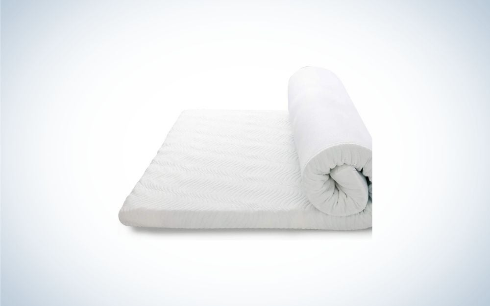 A white, double-sized memory foam mattress topper