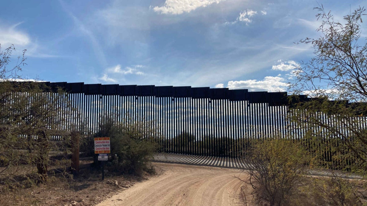 Steel beams of the border wall in the Sonoran Desert