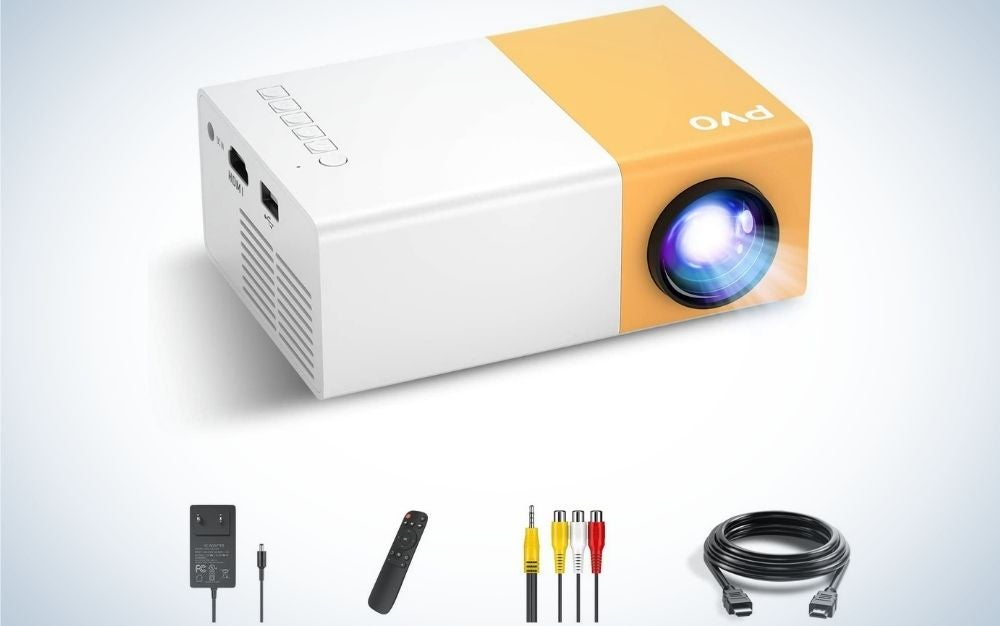 A white and orange square portable outdoor projector with a light flash beside it and with four accessories included.