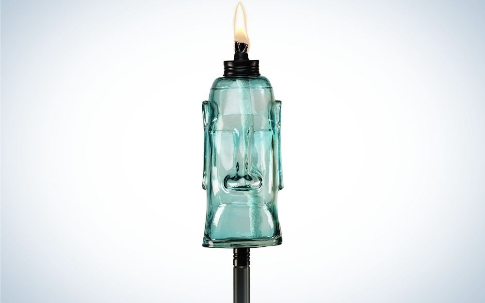 A blue King Oahu glass torch with flame on it.