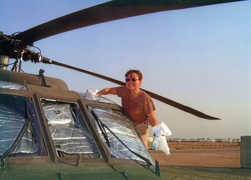 Tammy Duckworth cleans her helicopter in Iraq in 2004.