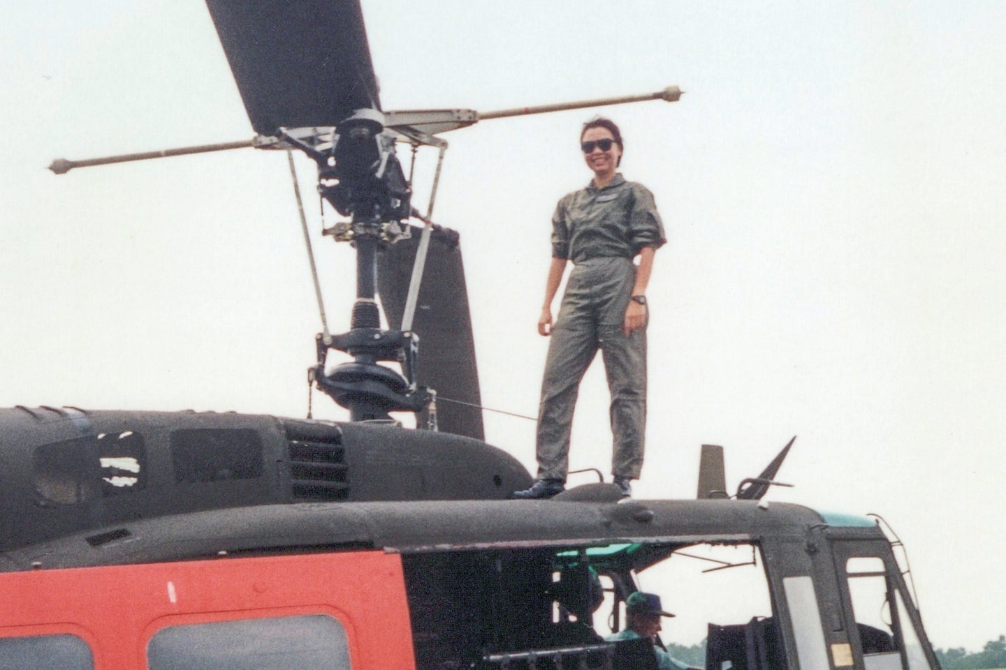 Senator Tammy Duckworth stands on a helicopter.