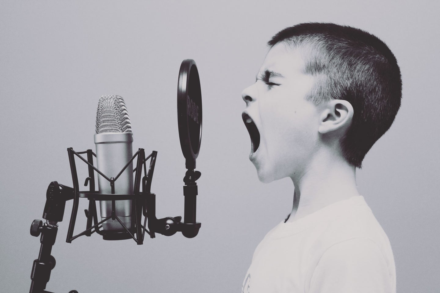 boy screaming into microphone