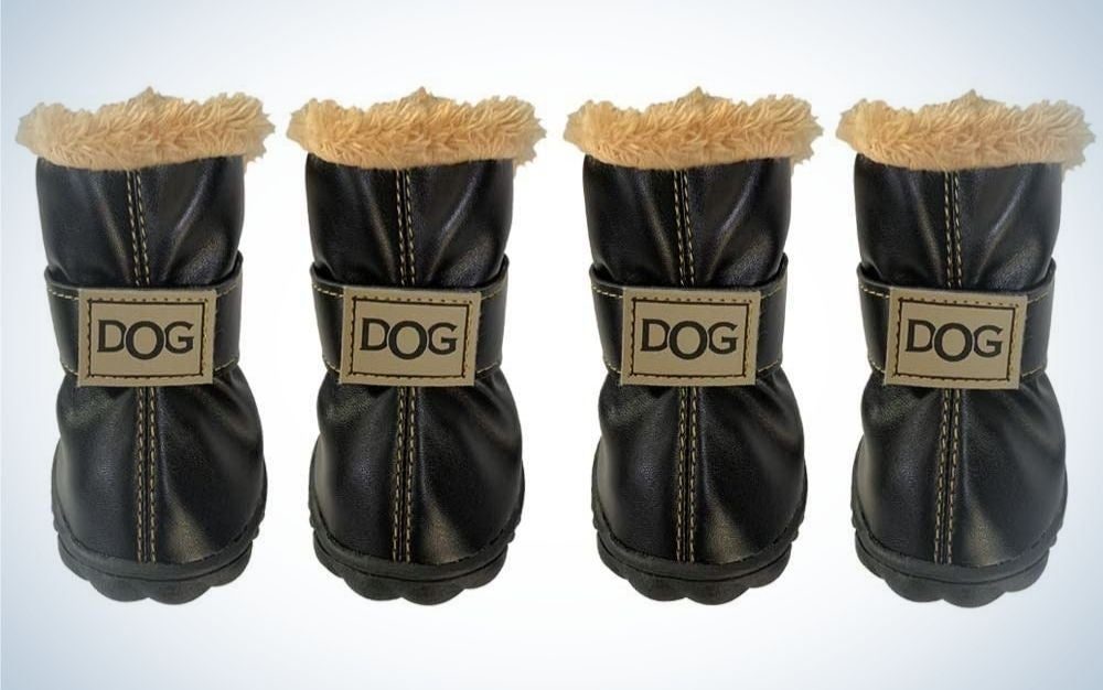 Four black pair of dog boots with beige fur on top of them and dog lettering with capitals in middle of each boot.