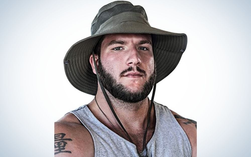 A man with a beard wearing a fishing hat