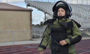 Meet the woman who set a record for running in a 96-pound bomb suit
