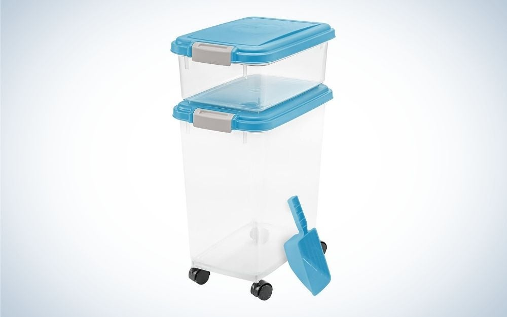 Clear pet airtight food containers with blue lids and blue food scoop