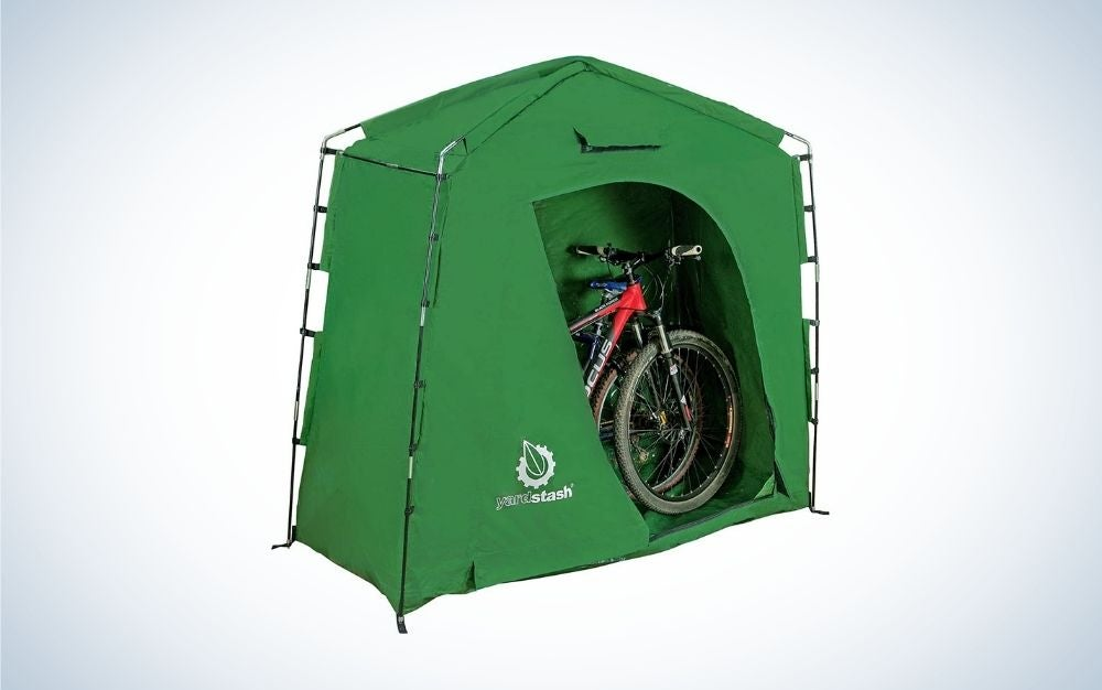 Green outdoor storage box for bikes