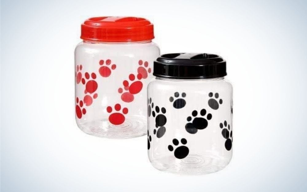 Two pet food containers, one with red paw prints and one with black paw prints