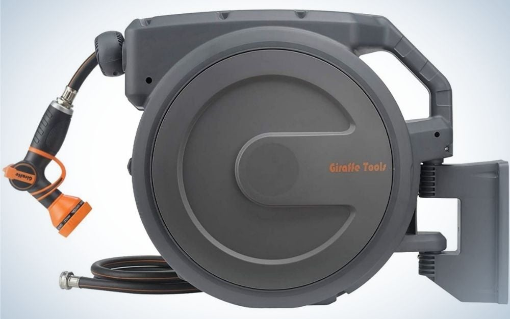 A dark grey Giraffe tools with a round body and a hose reel with orange head and a small black reel too.