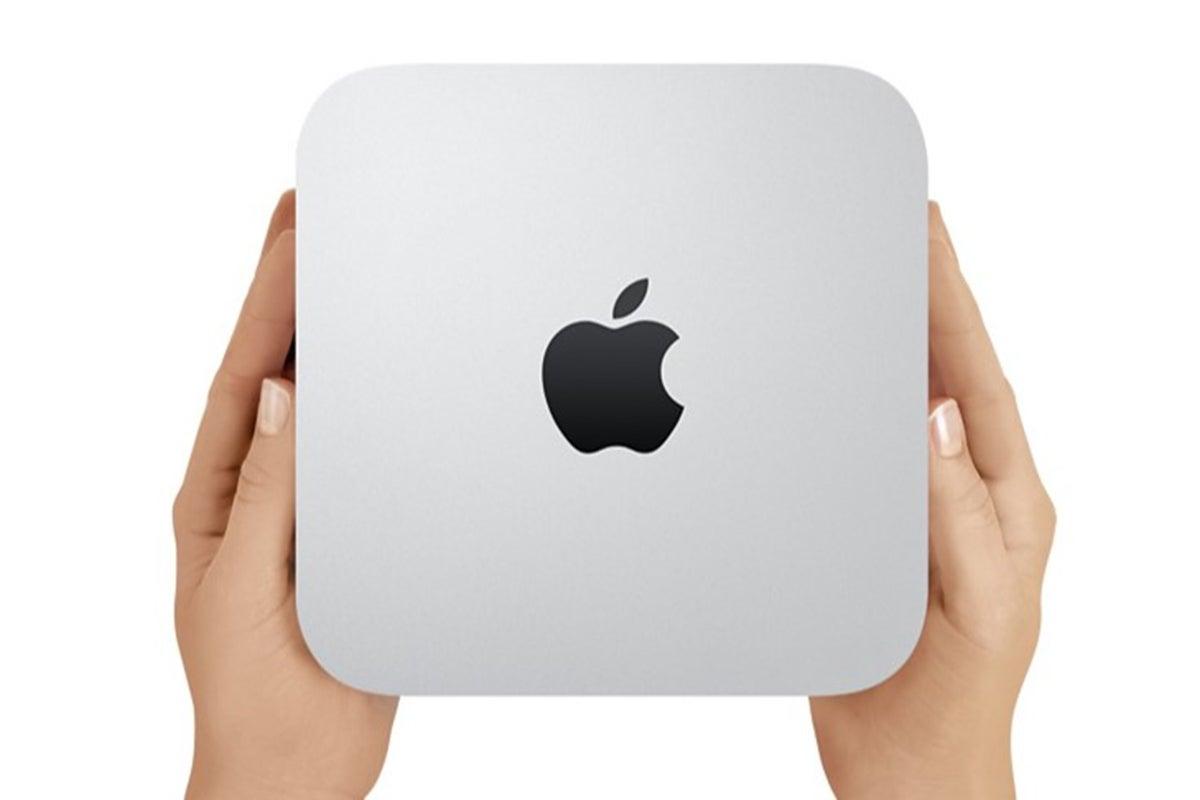 person holding mac mini