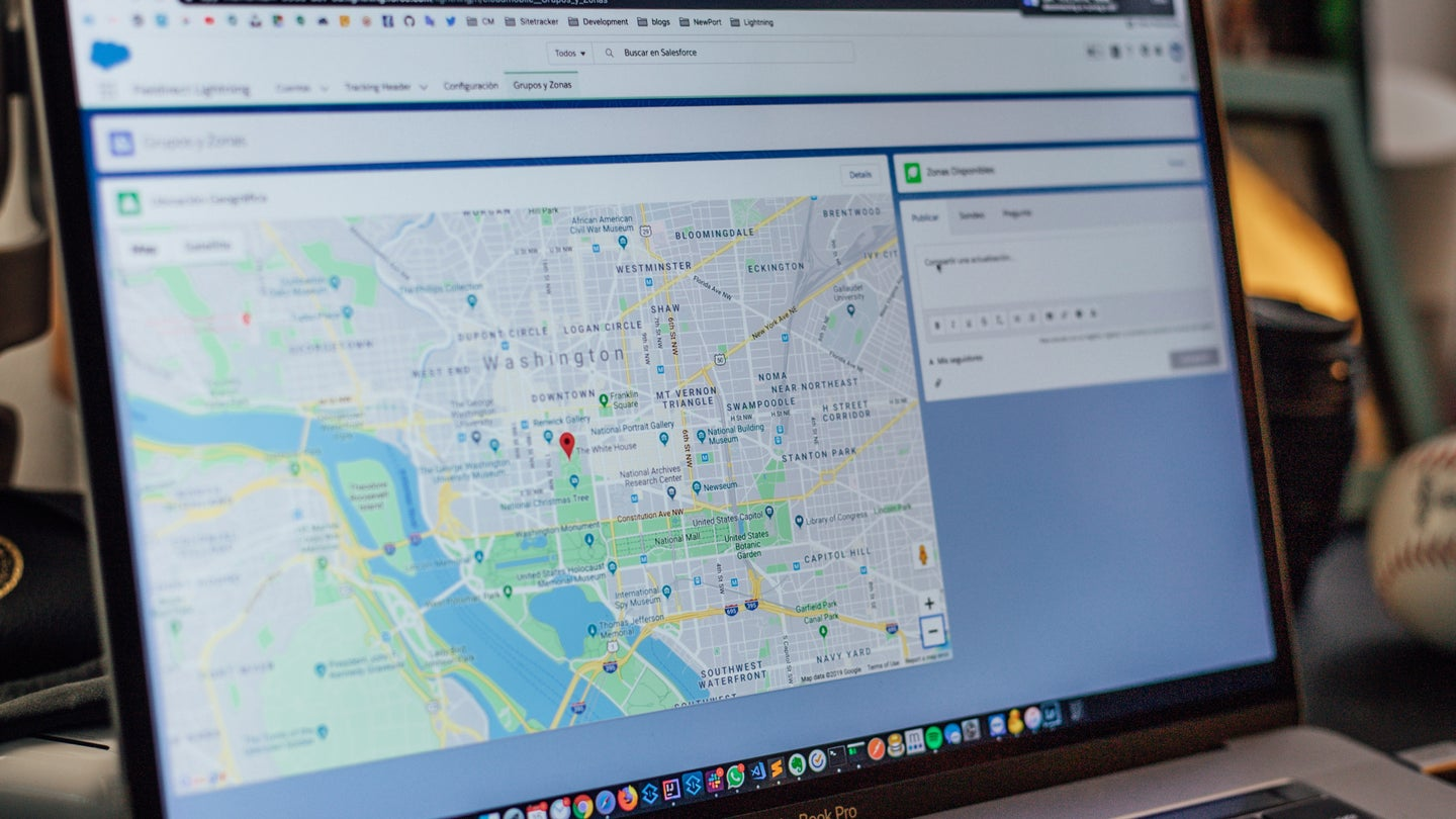 A laptop open with an image of Google Maps on the screen.