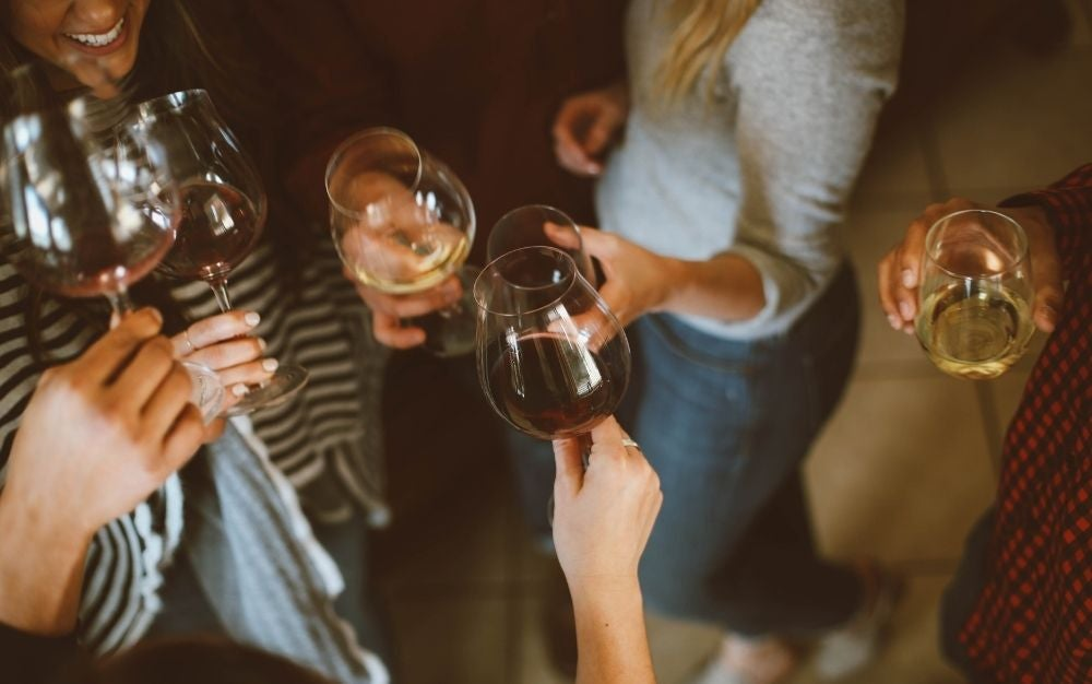 Group of people tossing best wine glasses