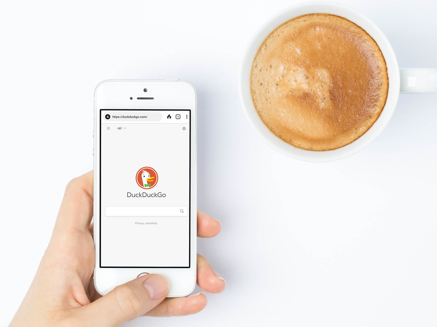 hand holding iphone with duckduckgo app