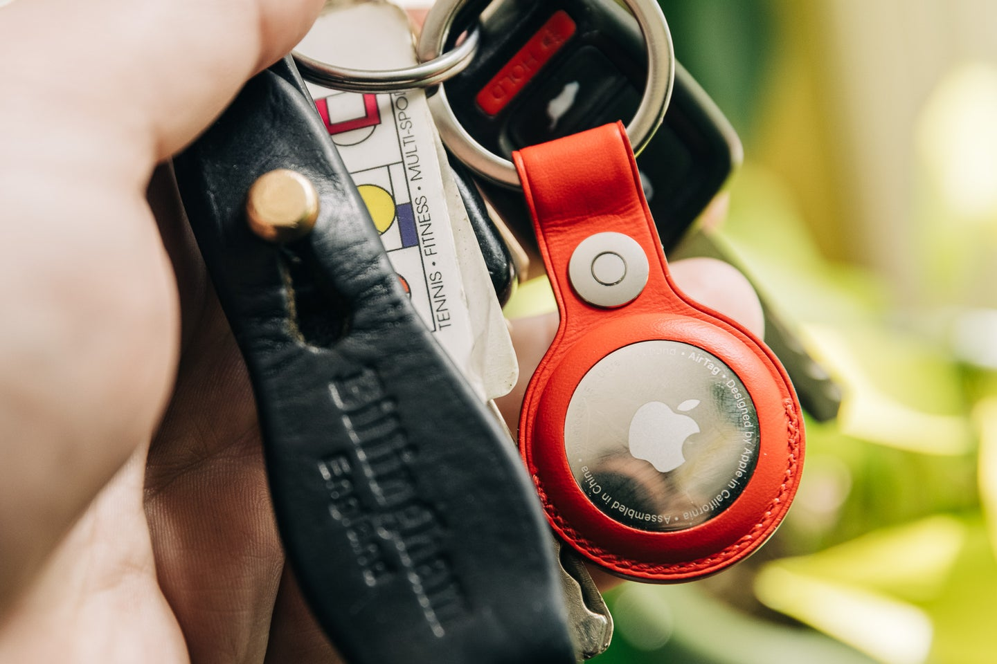Apple AirTag on keys with the red leather key ring