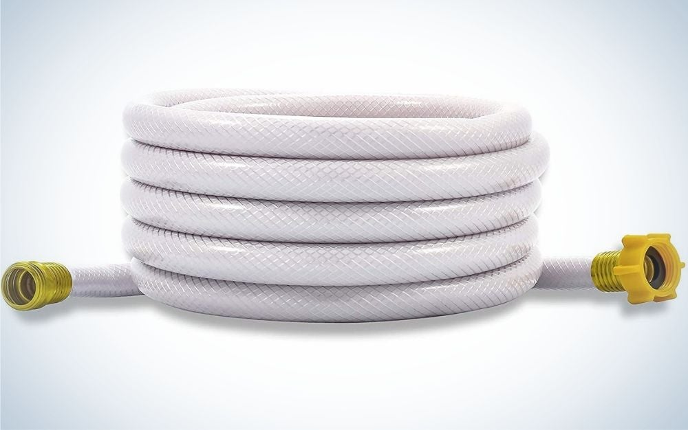 A big white long garden hose with gold heads in two sides.