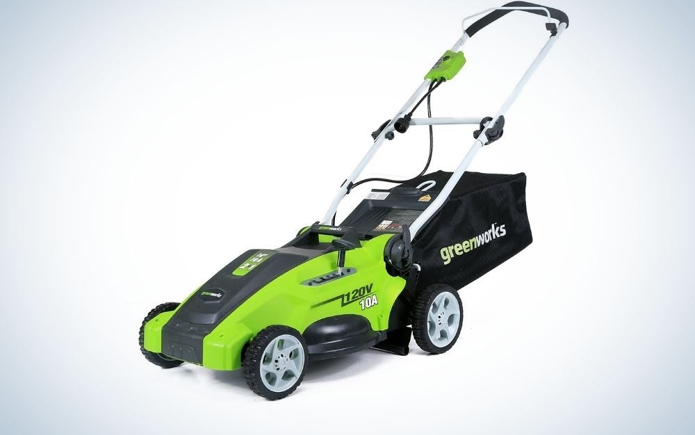 Four-wheeled green and black grass mower.