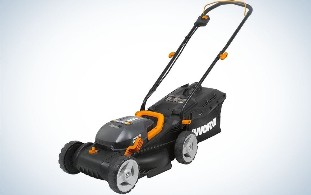 Black lawn mower and some orange four-wheeled parts