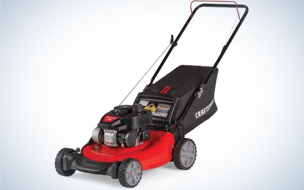 Walmart black lawn mower and some red four-wheeled parts.