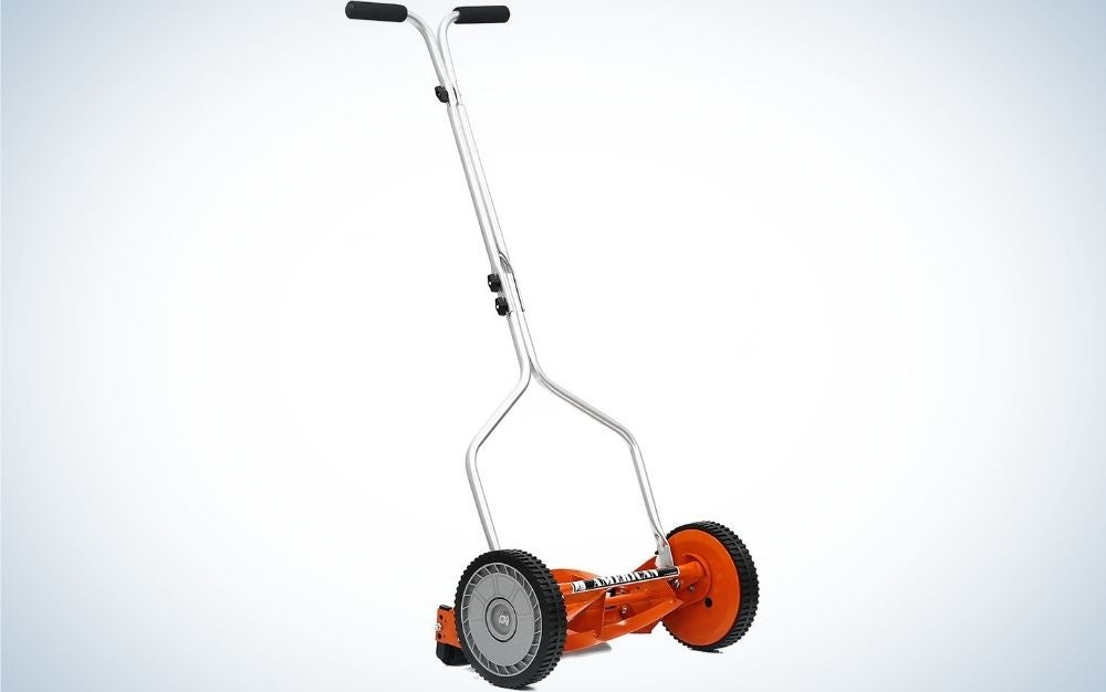 A red 4-Blade push reel lawn mower with grey wheels and metal body.