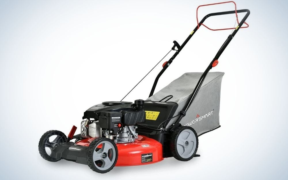 PowerSmart black lawn mower and some red four-wheeled parts and a grey back piece.