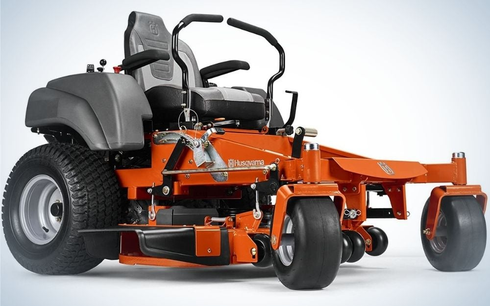 A large lawn mower in black and orange as well as with the elongated front, as well as two levers in the steering wheel function.
