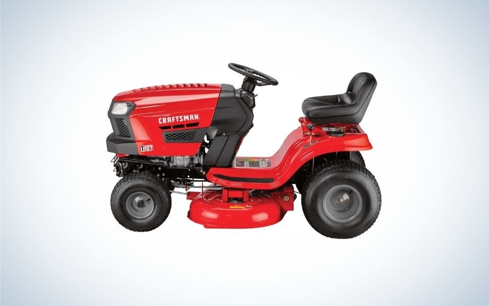 A red lawn mower with 4 black wheels and a black seat as well.