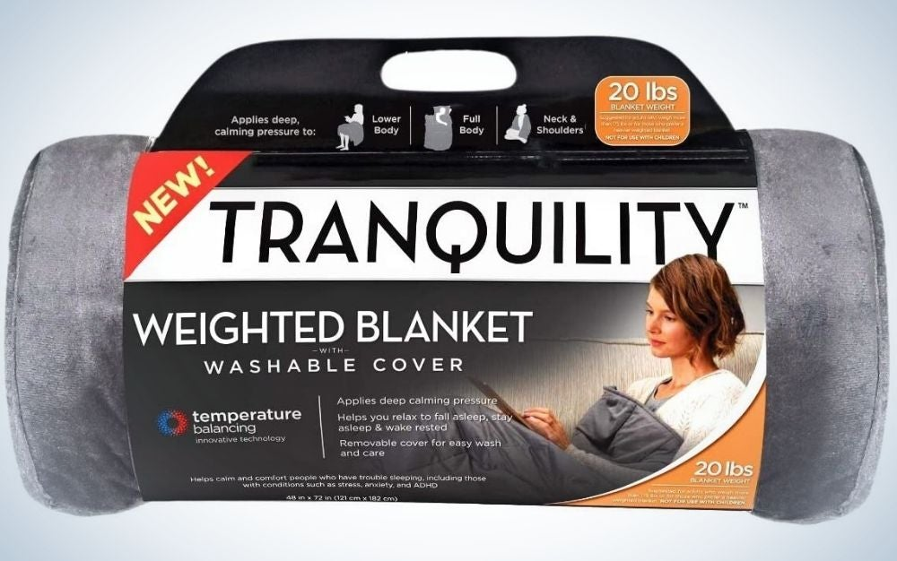 A grey blanket packed like a cylinder and packed with a cartoon lettering over it.