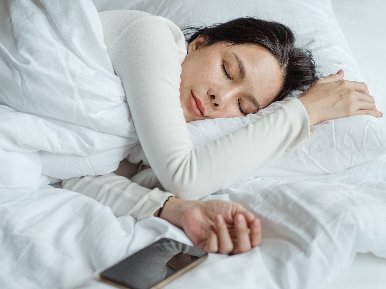 Person sleeping under weighted blanket