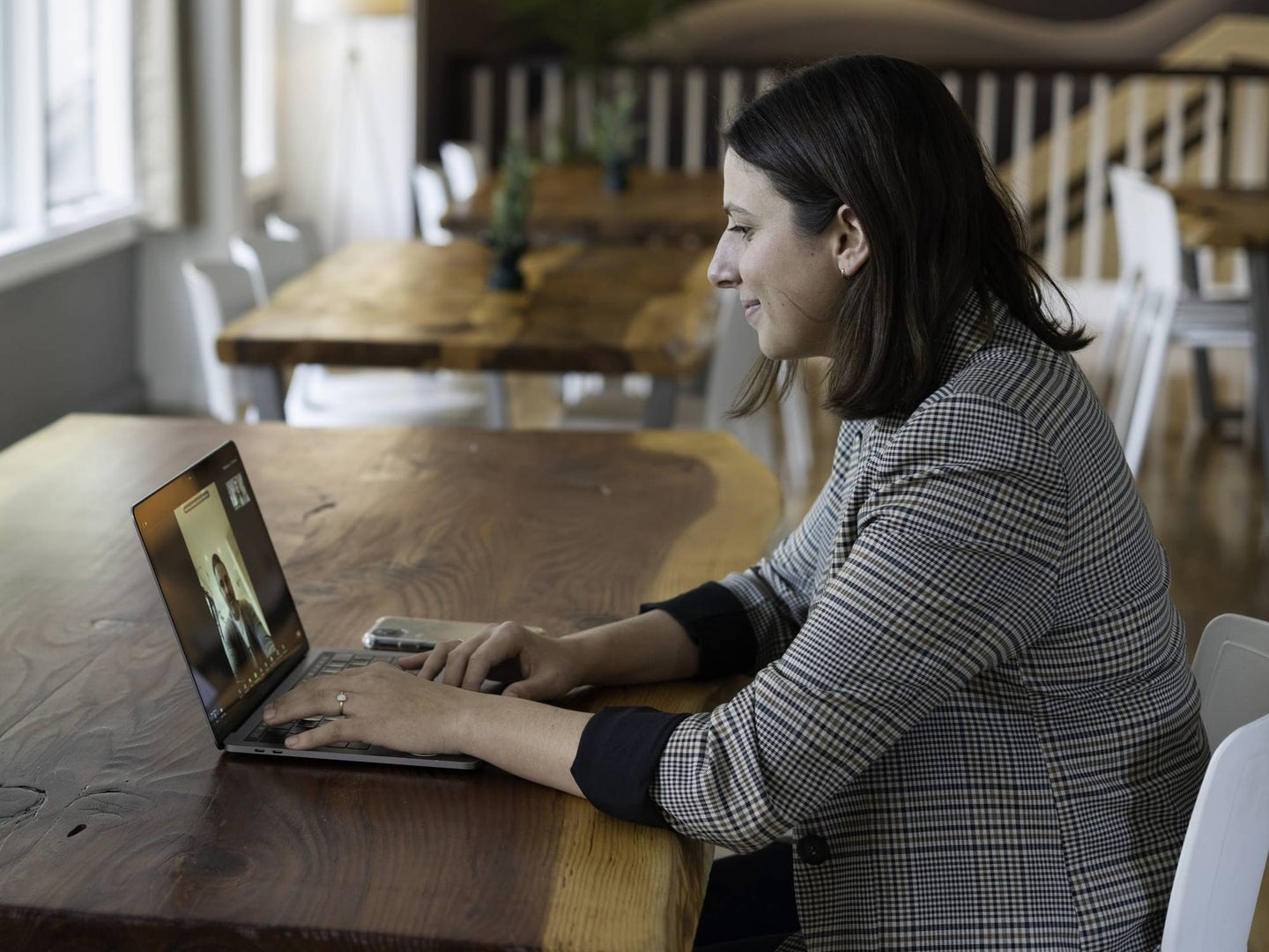 Person sitting at a table on a Zoom call