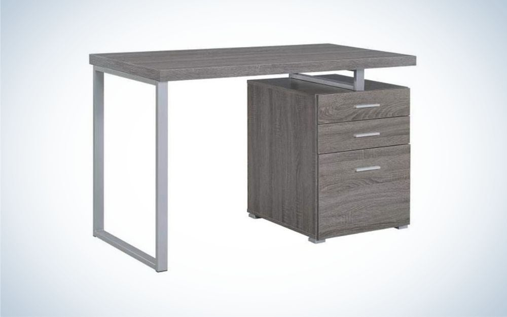 Grey file cabinet with three drawers and table