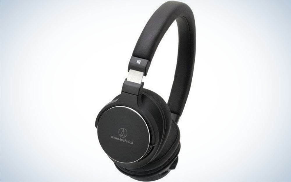 A pair of black headphones with the part that is placed on the ears large enough to cover them.A pair of black headphones with the part that is placed on the ears large enough to cover them.