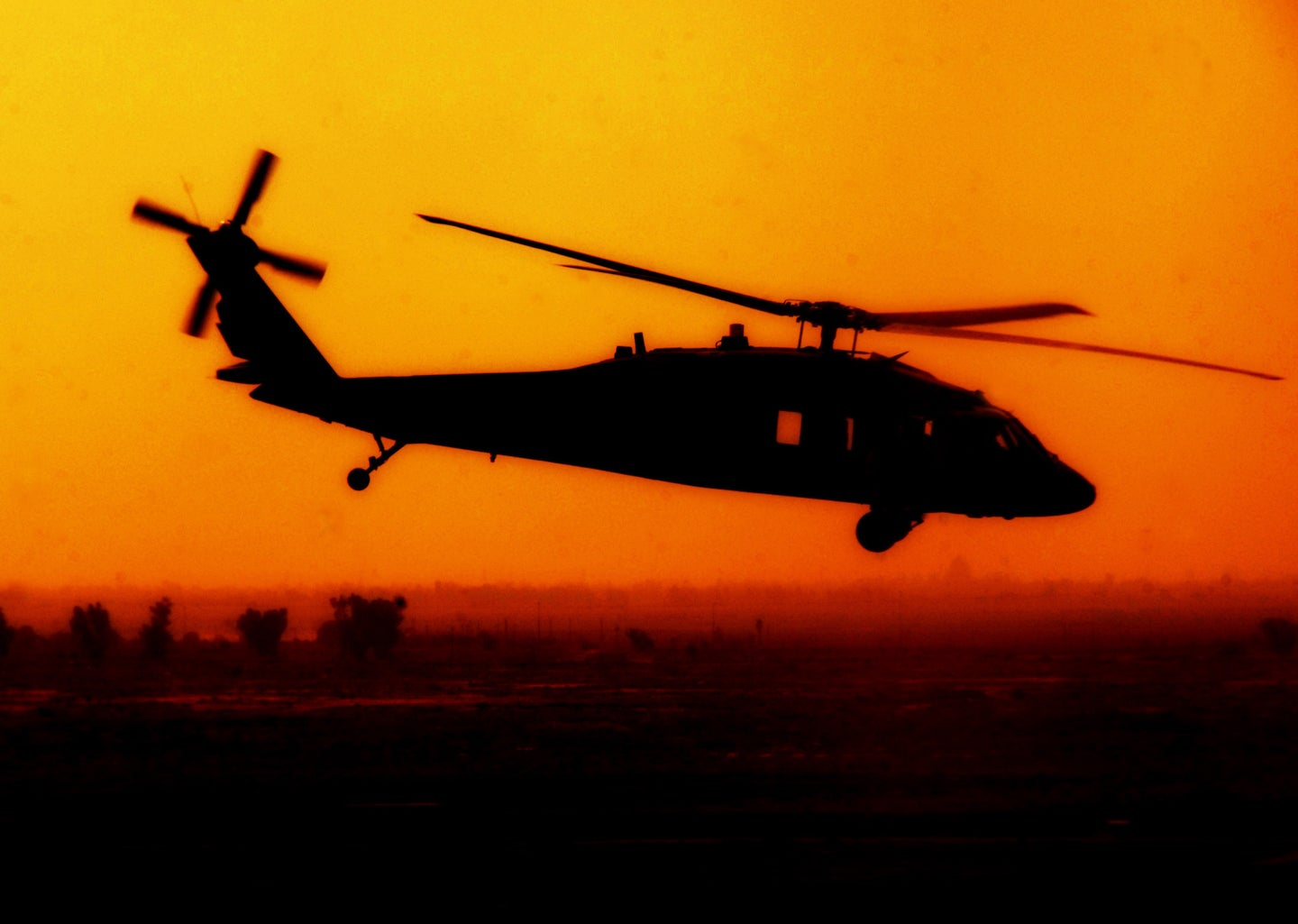 A flying Black Hawk helicopter in Iraq.