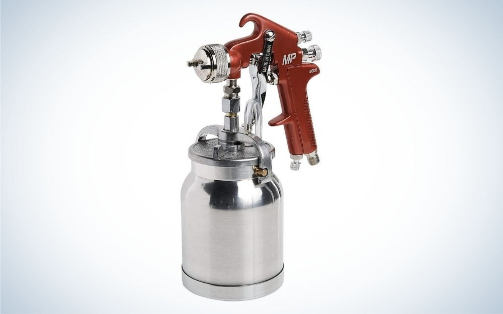 Paint spray gun with a red handle and a cup